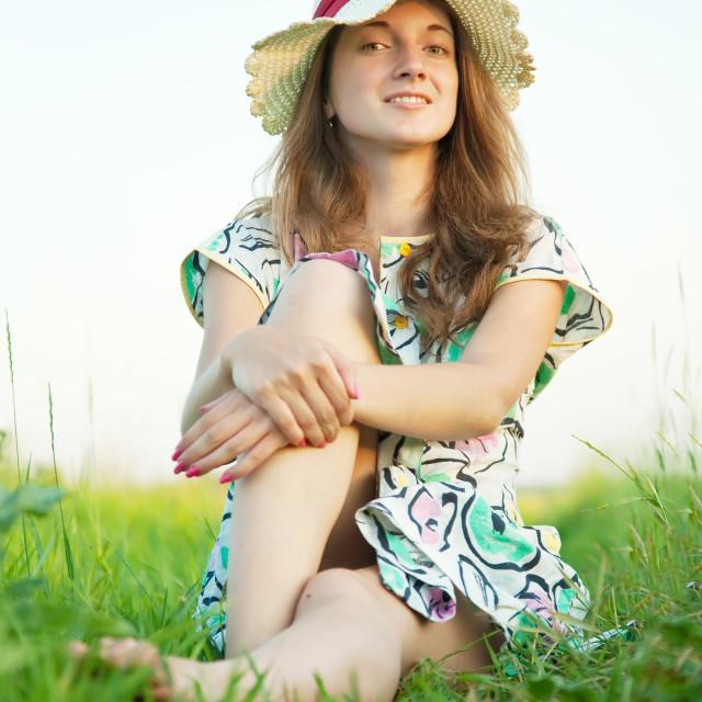 """girl sitting on meadow"" stock image"
