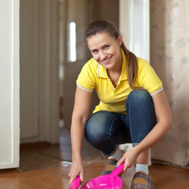 """""""Girl sweeps the floor"""" stock image"""