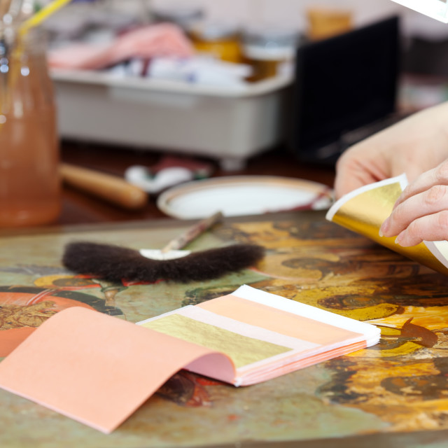"""""""Restorer gilding on the old icon"""" stock image"""