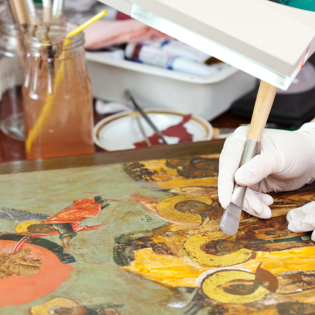 """""""Restorer gilding on icon with agate burnisher"""" stock image"""