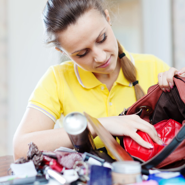 """woman searching something in handbag"" stock image"
