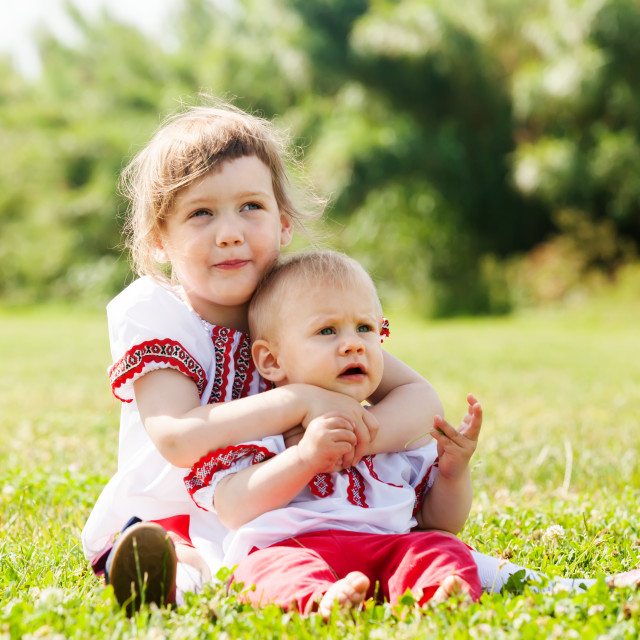 """""""children in traditional clothes on grass"""" stock image"""