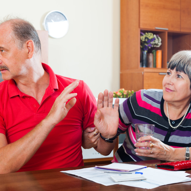 """couple having quarrel over documents"" stock image"