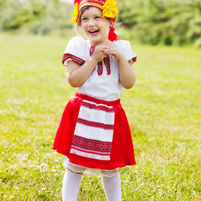"""""""child in traditional folk clothes"""" stock image"""