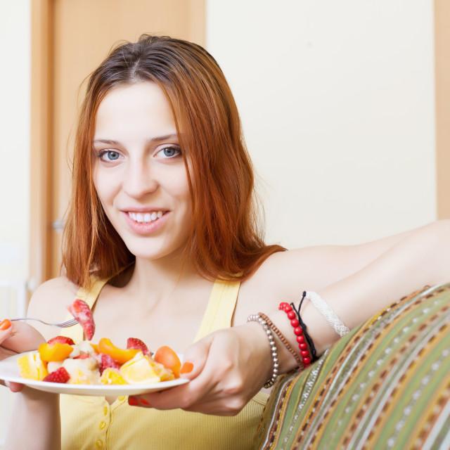 """red-hair woman eating fruits salad"" stock image"