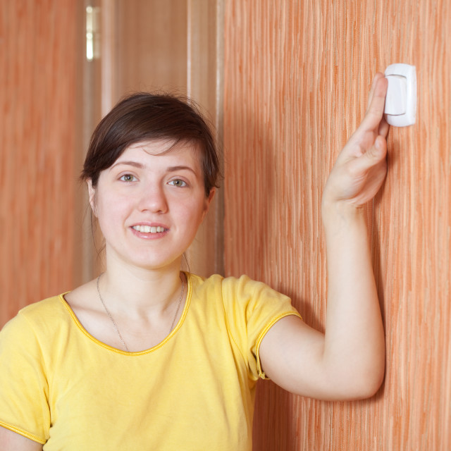 """""""woman turning off the light switch"""" stock image"""