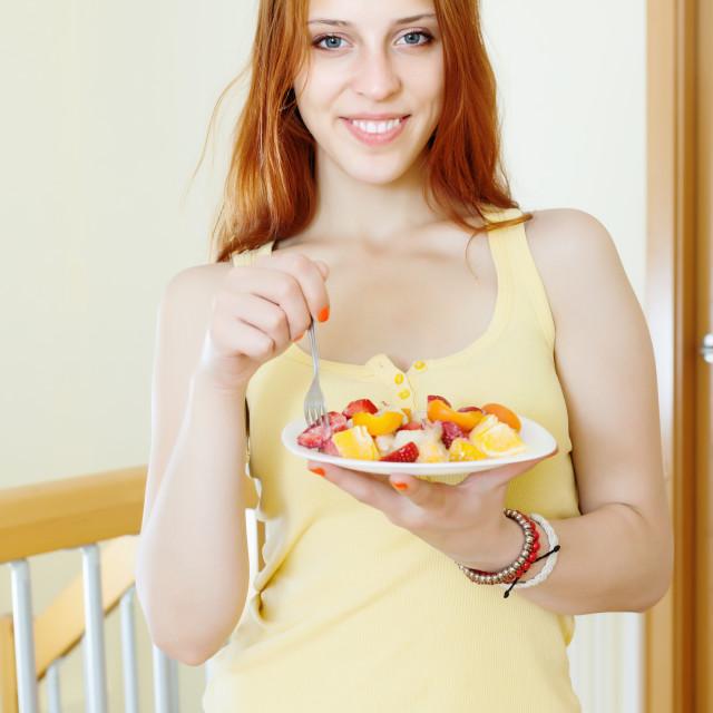 """girl eating fruits salad"" stock image"