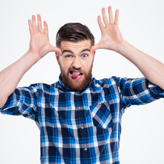 """""""Man showing big ears with his hands and tongue"""" stock image"""