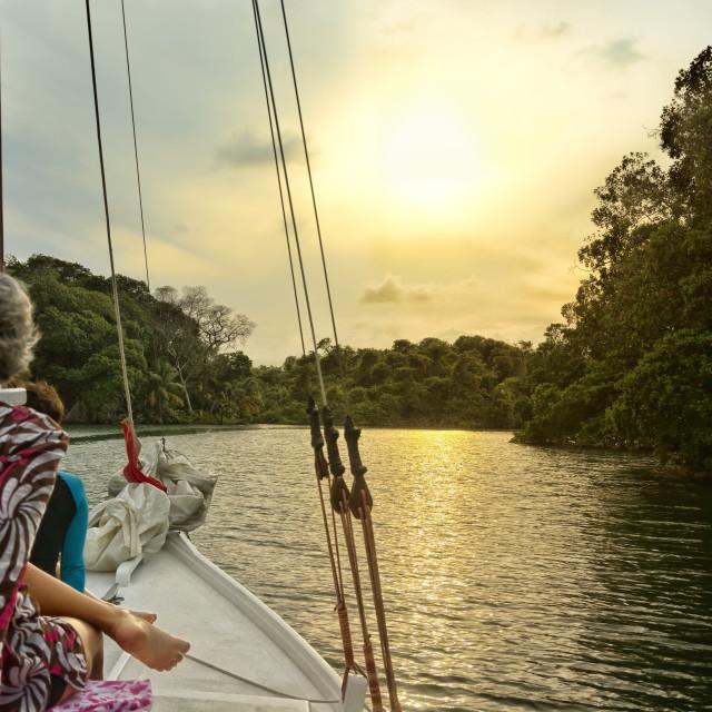 """""""Sailing toward the sunset"""" stock image"""