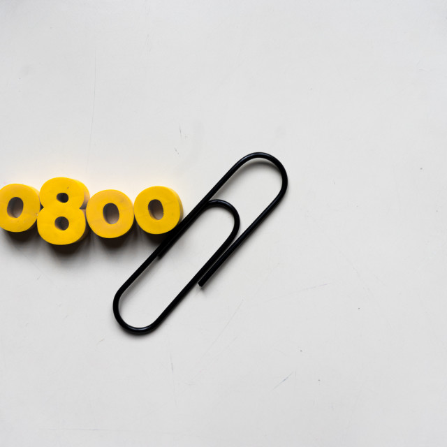 """Numbers and a pin"" stock image"