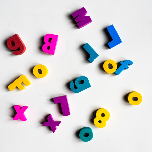 """Colorful letters scrambled all over"" stock image"