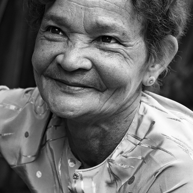 """""""Old woman at the Mekong Delta."""" stock image"""