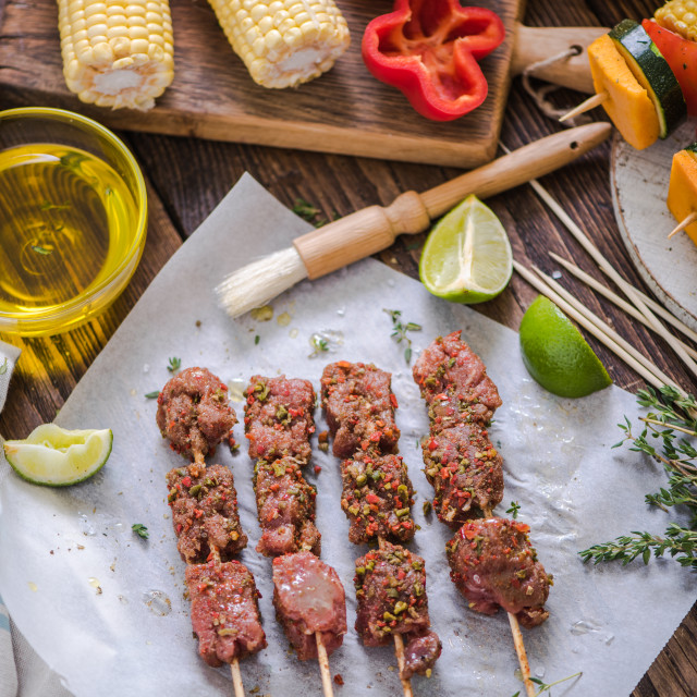 """marinate beef kebabs on wooden table"" stock image"