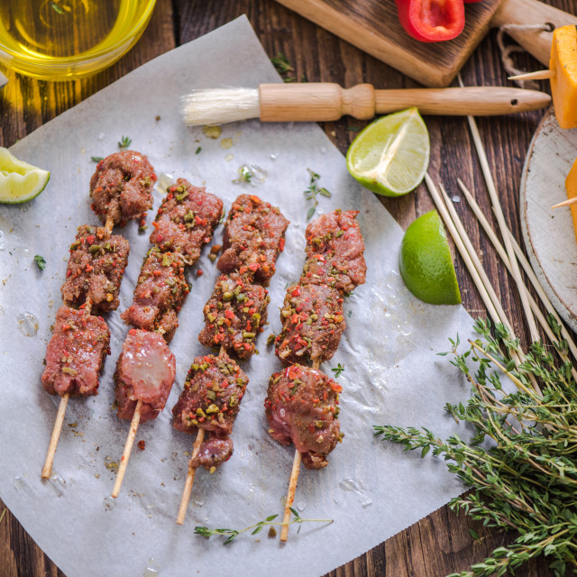 """marinate beef skewers on wooden table"" stock image"