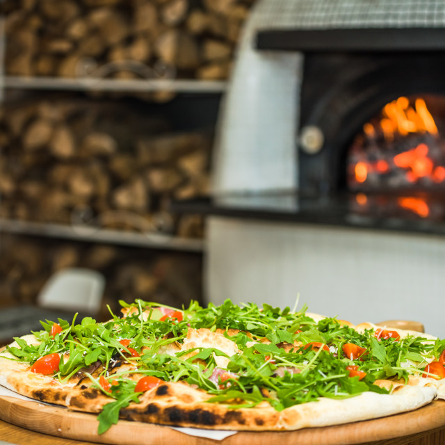 """vegeterian pizza with oven in background"" stock image"