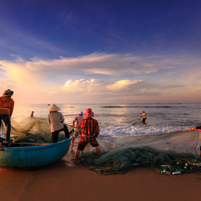 """fishermen who pull up the fishing nets in sunrise"" stock image"