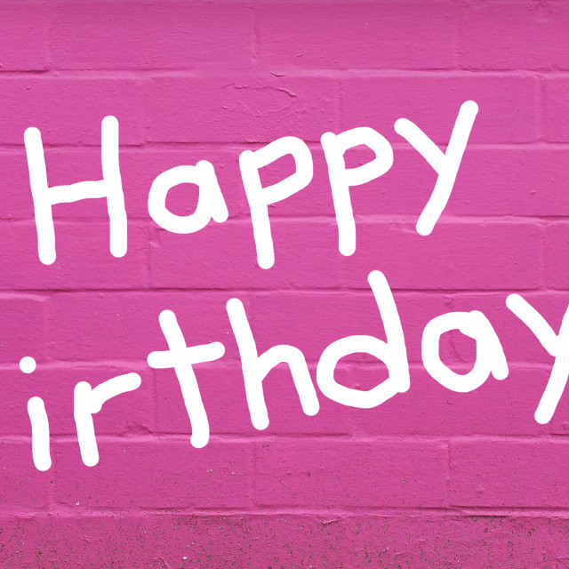 """Happy birthday over pink brick wall"" stock image"