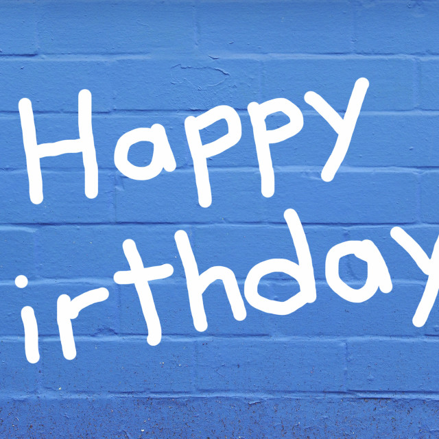 """Happy birthday over blue brick wall"" stock image"