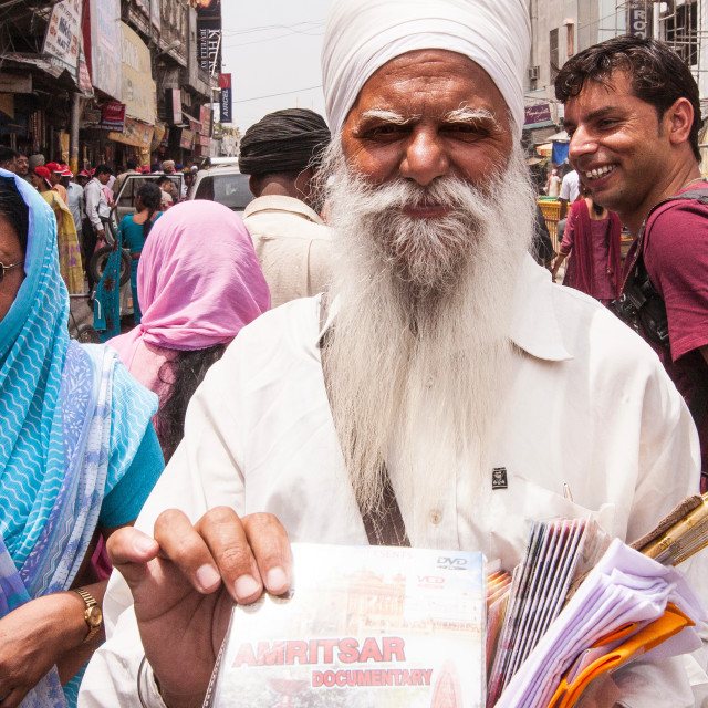 """Old man selling DVD of Jallianwala Bagh massacre, Amritsar, Punjab, India"" stock image"