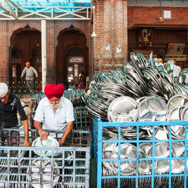 """Utensils putting in order to serve at Langar (free food) at the Golden Temple or Harmandir Sahib, Amritsar, Punjab, India"" stock image"