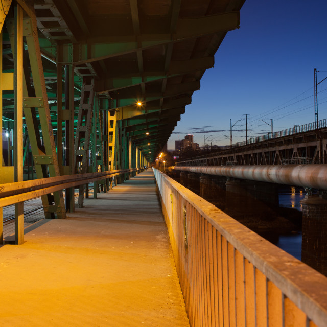 """Pedestrian Path on a Bridge at Night"" stock image"