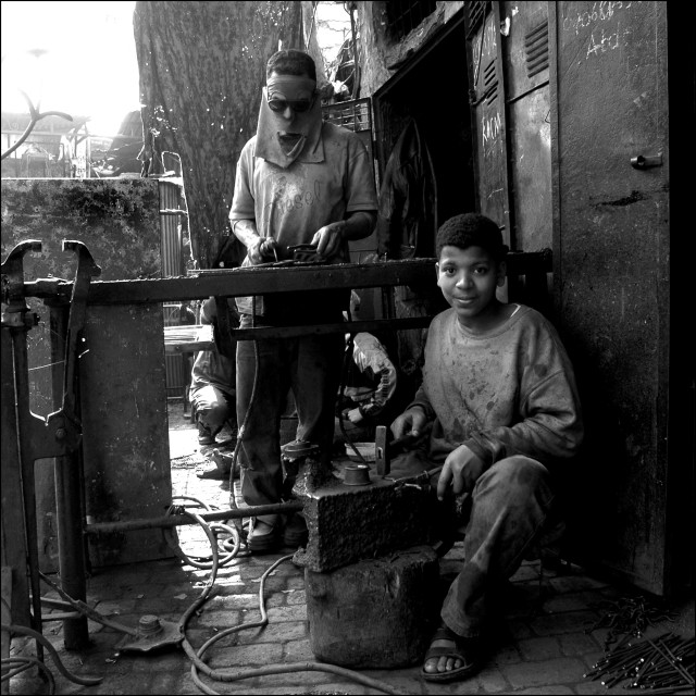"""""""Young Metalworker in the Souks of Marrakech"""" stock image"""