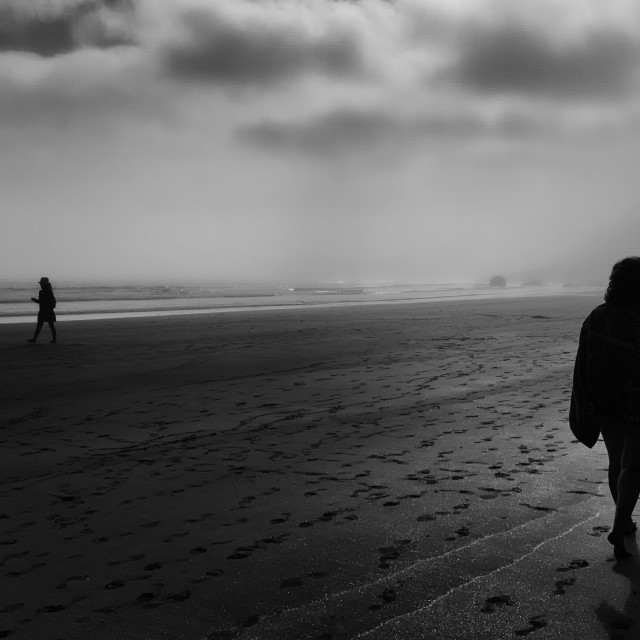 """Figures on a Misty Beach"" stock image"