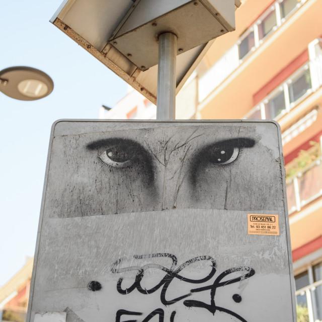 """Eyes sprayed onto solar panel post, Barcelona, Spain"" stock image"