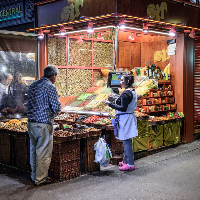 """""""Market Trader selling her wares to a customer"""" stock image"""