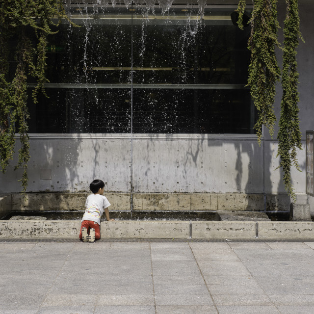 """""""Anonymous Boy Playing by Waterfall Pool"""" stock image"""