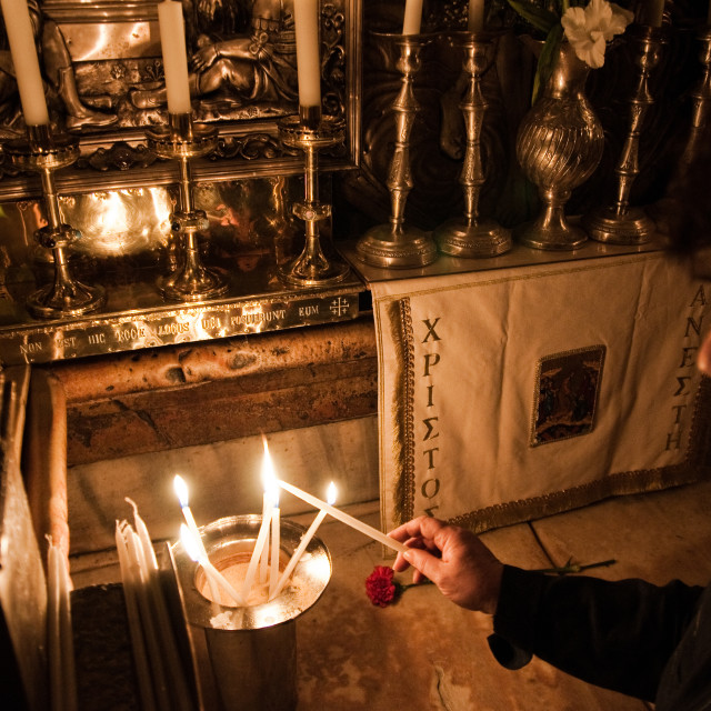 """Lighting a candle inside the Church of the Holy Sepulchre, Jerusalem, Israel"" stock image"