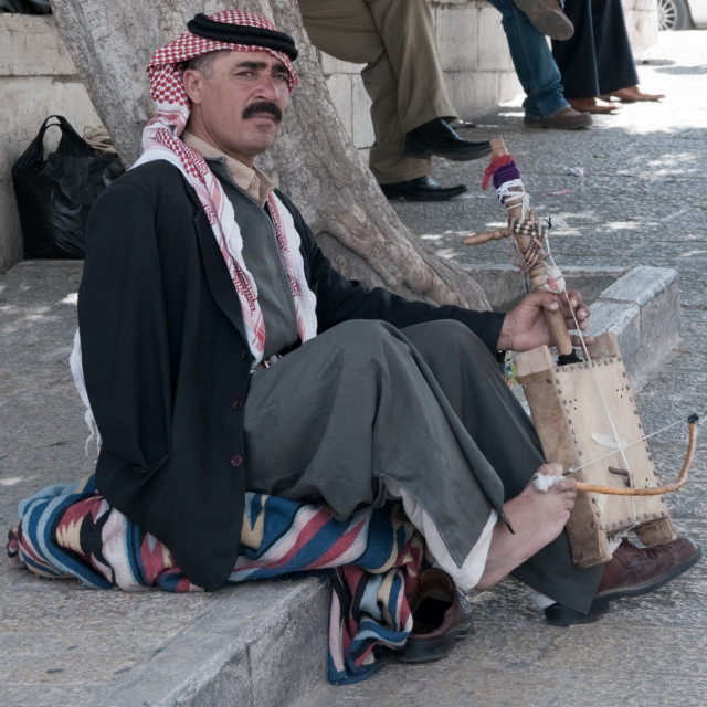 """One armed musician playing an instrument with his foot, Manger Square, Bethlehem"" stock image"