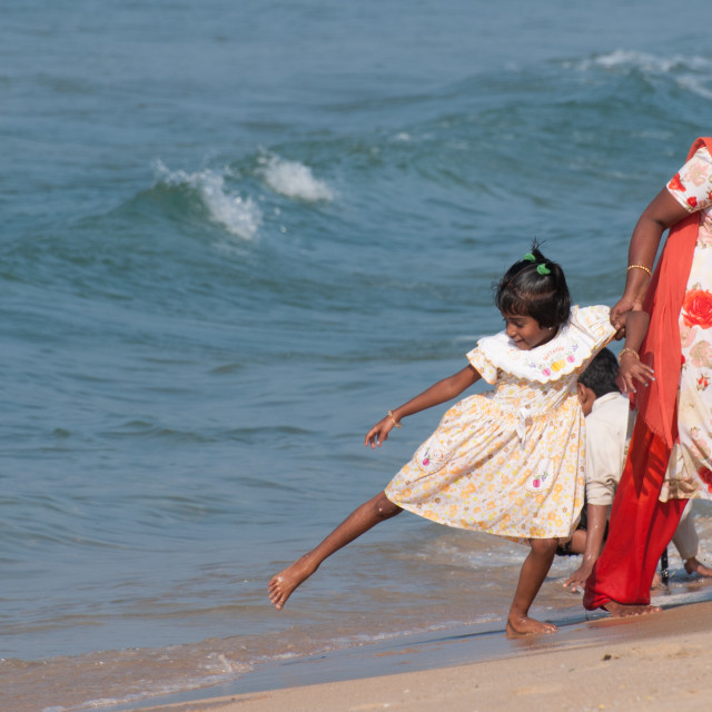 """Family on beach, Varkala, India"" stock image"