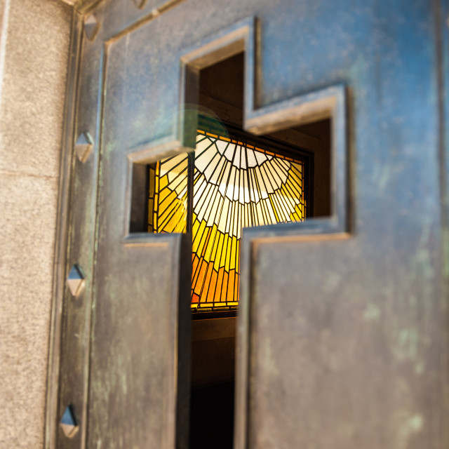 """Stained glass visible through cross shaped door, Buenos Airies, Argentina"" stock image"