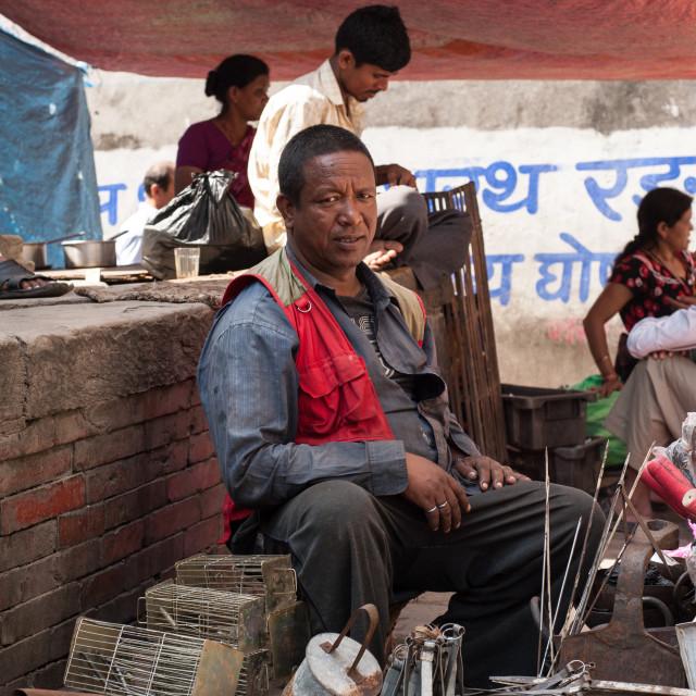 """Man selling scrap at a local market, Kathmandu, Nepal"" stock image"