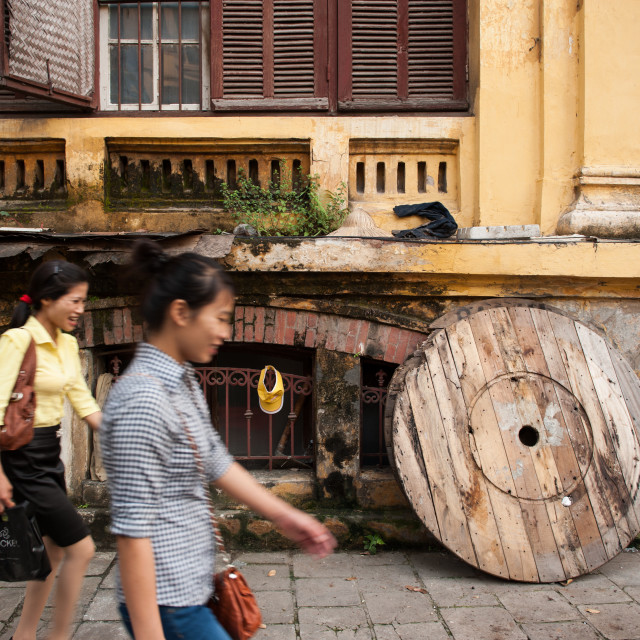 """Two smiling women walking through Hanoi, Vietnam"" stock image"