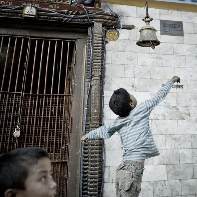 """Jumping to ring a bell, Kathmandu, Nepal"" stock image"