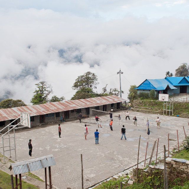 """Playing volleyball in the clouds, AnnaPurna Circuit, Himalayas, Nepal"" stock image"