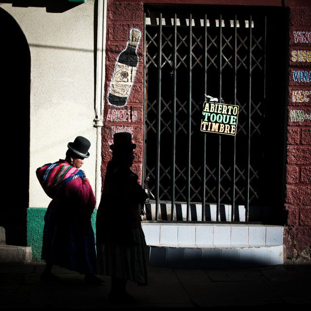 """Two Bolivian women walking through La Paz, Bolivia"" stock image"