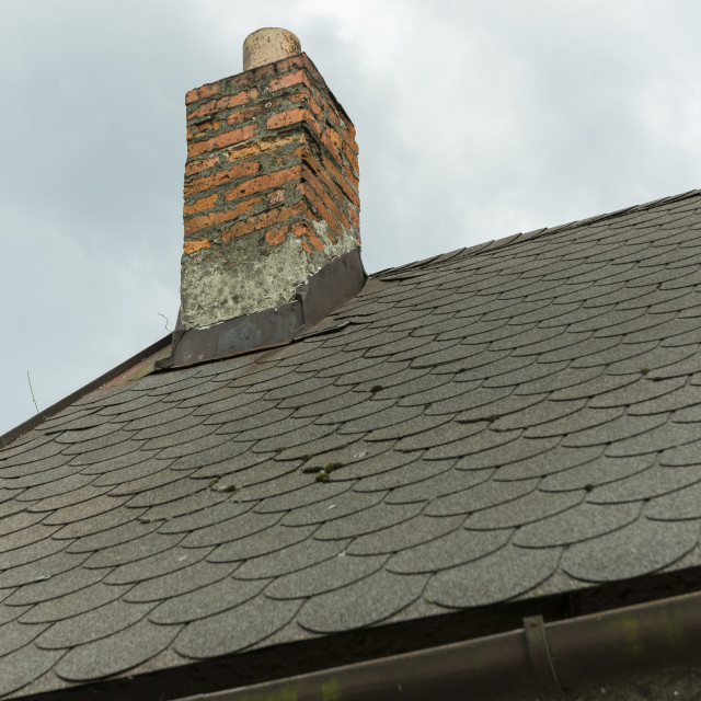 """""""crumbling chimney on the roof"""" stock image"""