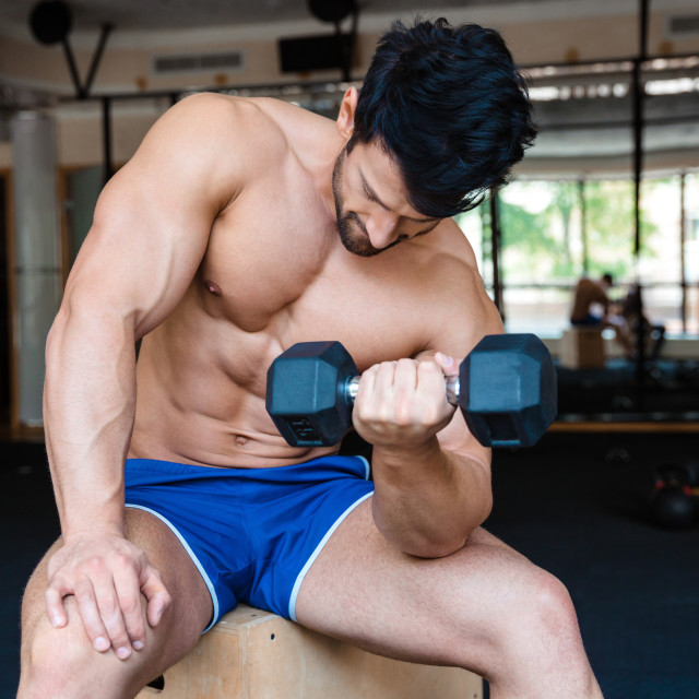 """Handsome man workout with dumbbell"" stock image"