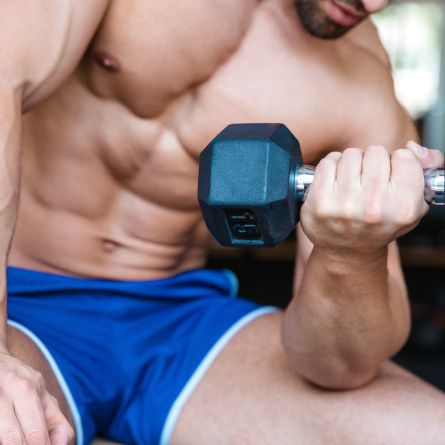 """Bodybuilder workout with dumbbell"" stock image"