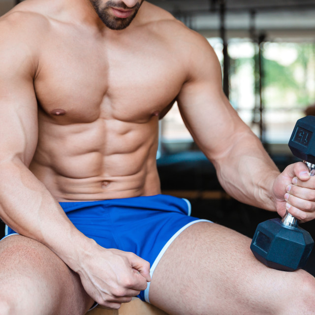 """Muscular man workout with dumbbell"" stock image"