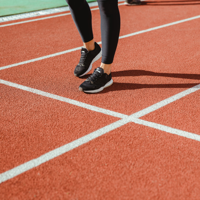 """Female runner legs at stadium"" stock image"