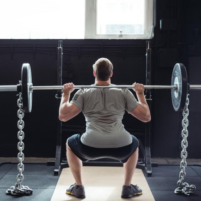 """Man weightlifting"" stock image"