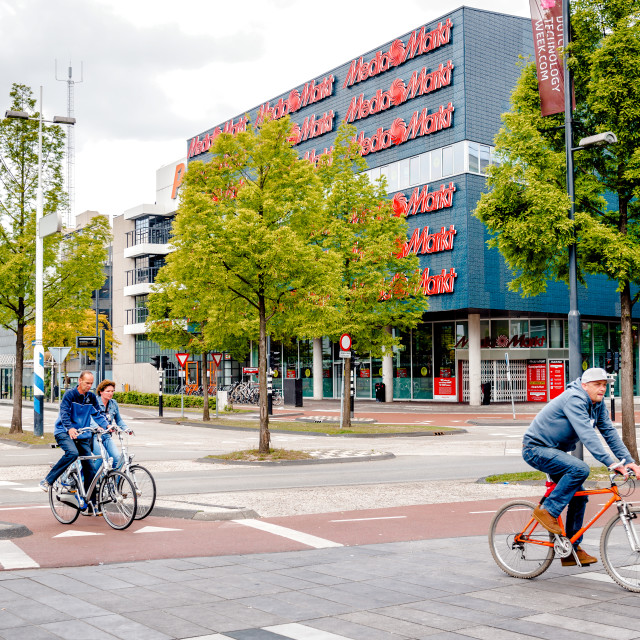 """""""Eindhoven, Netherlands- May 24, 2015: People crossing the street by bicycle...."""" stock image"""