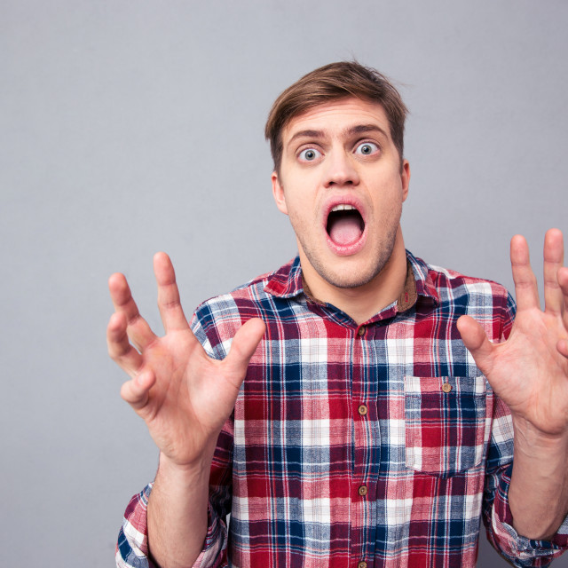 """""""Terrified frightened young man screaming with open mouth"""" stock image"""