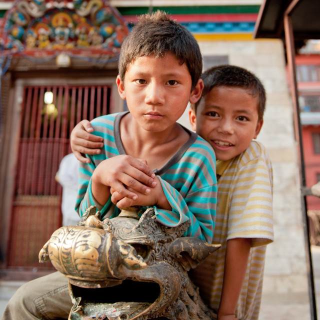 """Two friends sitting on a dragon, Kathmandhu, Nepal"" stock image"