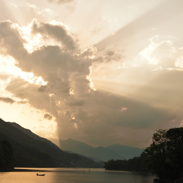 """Sunrays peeking through clouds, Pokhara, Nepal"" stock image"