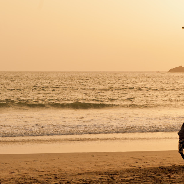 """Cricket at sundown, Palolem Beach, Goa, Southern India"" stock image"